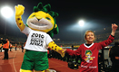 Official mascot of World Cup 2010 - 'Zakumi' and his young friend, at the stadium