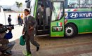 Mexican team members deboarding the National Team Bus